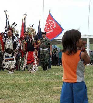 A child watches a Color Guard Veteran's Pow Wow at the Pine Ridge Indian Reservation. (Photo: Hamner_Fotos)