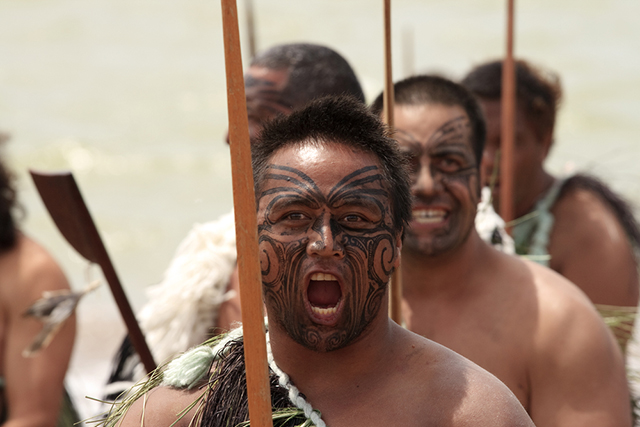 A Maori warrior chants at a Haka during a Waitangi Day celebration, February 6, 2009, in Waitangi, New Zealand. The Maori are one of many groups that have struggled against the violent effects of colonization on their languages. (Photo: Patricia Hofmeester / Shutterstock.com)