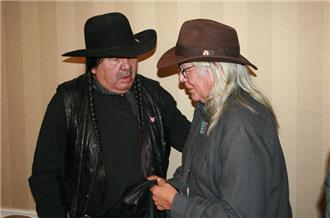 "Tom Poor Bear (left), Oglala Vice President, said ""The only thing Leonard [Peltier] is guilty of is carrying the responsibility of our ancestors."" [Jason Coppola/Al Jazeera]"