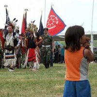 "A child watches a Color Guard Veteran's Pow Wow at the Pine Ridge Indian Reservation. (Photo: <a href=""http://www.flickr.com/photos/jonathan_hamner/3402564242/"" target=""_blank"">Hamner_Fotos</a>)"